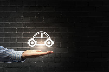 Concept of showing a car in the palm of your hand.