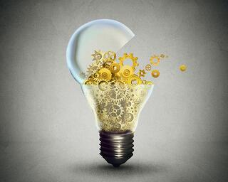 Creative technology and communication concept as an open door light bulb transferring gears and cogs.Business metaphor for downloading or uploading innovation solutions..jpeg