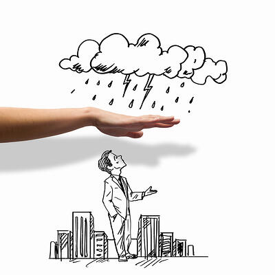 Hand drawing image of businessman with hand protecting him from rain
