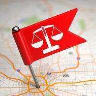 Justice Concept - Small Flag on a Map Background with Selective Focus.