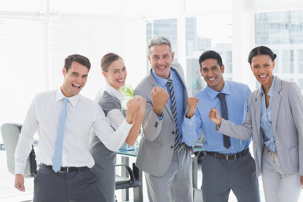 Portrait of cheerful business people cheering in the office.jpeg